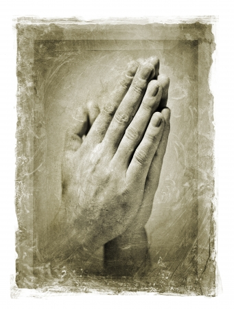 clasped: Grainy and stained image of hands clasped in a prayer. Stock Photo