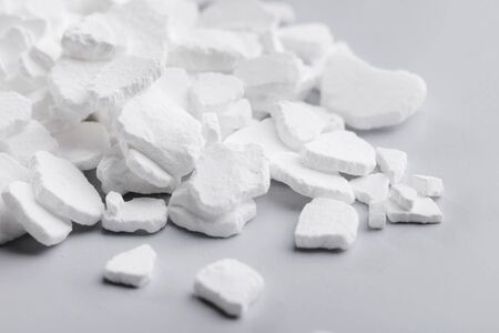 desiccation: Calcium chloride (CaCl2) flakes. Common applications include brine for refrigeration plants, ice and dust control on roads, and desiccation.