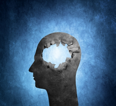 alzheimers: Conceptual image of a cardboard head with a hole.