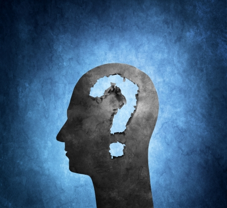 questionmark: Human head cardboard silhouette with torn holes shaped like a question mark. Stock Photo