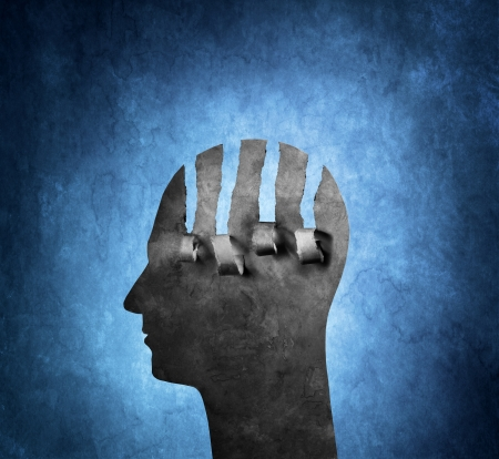 A Torn artistic cardboard head on blue background. Stockfoto