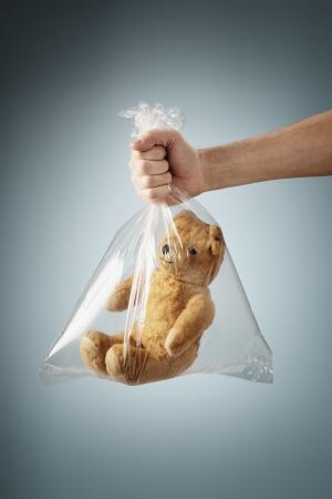 bagged: Old generic teddybear in a clear plastic bag.