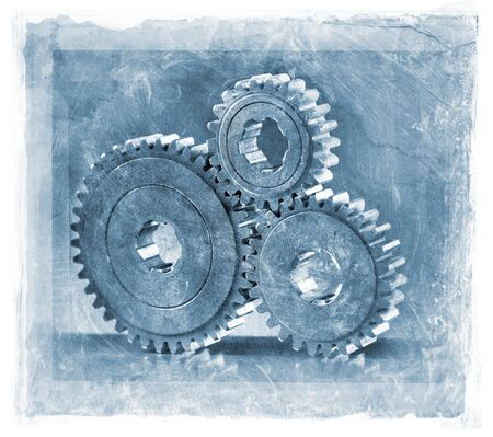 gritty: grainy and gritty manipulated photo of three cog gears. Stock Photo