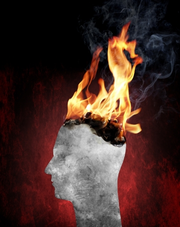 Conceptual image of a head burning in flames. Stock Photo - 16438806
