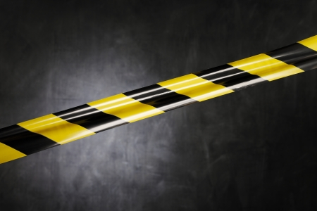 cordon: Black and yellow plastic barrier tape blocking the way.