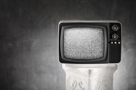 static: Old portable television with static noise.