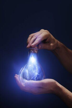 Conceptual image of a lightning captured in a bottle. Standard-Bild