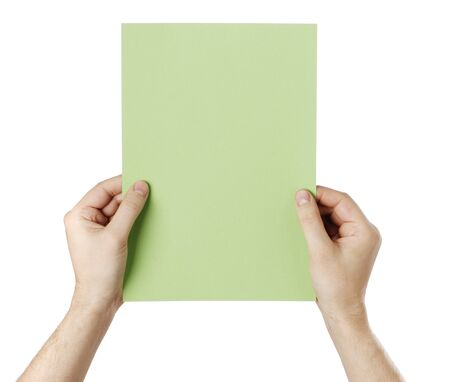 Man holding a blank light green paper against white background. Stock Photo - 18724855