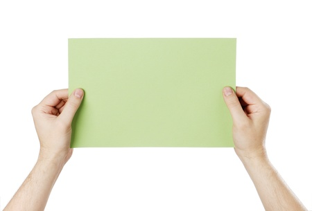Man holding a blank light green paper against white background. Stock Photo - 18724858