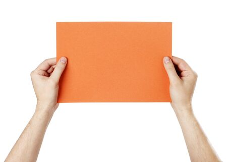 Man holding a blank orange paper against white background. Stock Photo - 18724866