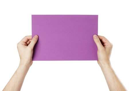 Man holding a blank purple paper against white background. Stock Photo - 18724869