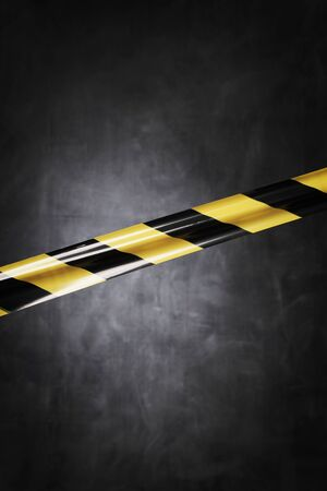 affix: Black and yellow plastic barrier tape blocking the way.