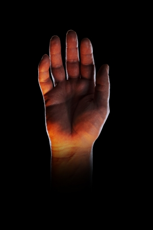 bodypart: Bizarre image of a hand, lit with orange light from below.