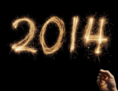 Man writing number 2014 with a sparkler in his hand Stock Photo - 21928219