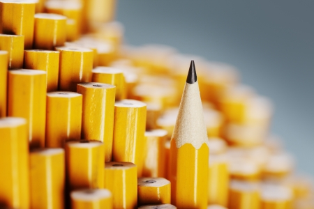 One sharpened pencil standing out from the blunt ones.  Stock Photo
