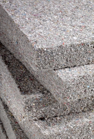 heat loss: Stack of cellulose insulation batt panels, made of recycled newspapers, used as building thermal insulation. Stock Photo