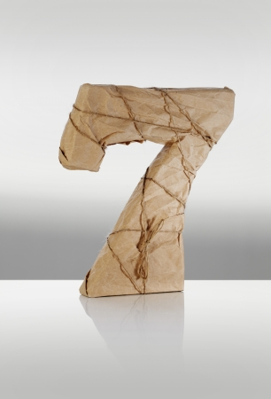 seventh: Number seven wrapped in brown paper. Stock Photo
