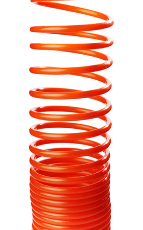 compressed air hose: Orange red thin spiral air hose used for pneumatic tools.