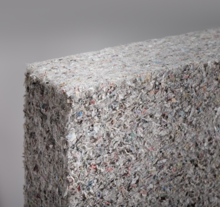 Cellulose insulation batt panel in closeup, made of recycled newspapers, used as building thermal insulation. Short depth-of-field.