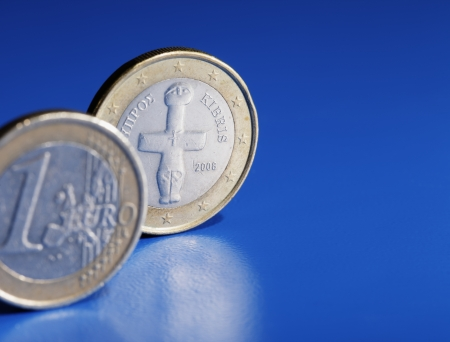 kibris: Euro coins from Cyprus on blue background. Stock Photo