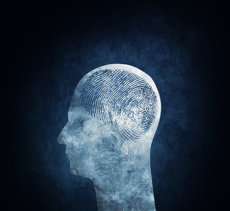 Conceptual image of a head with a fingerprint brain. photo