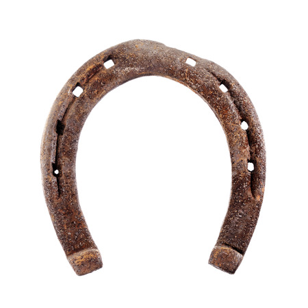 Old rusty and worn horseshoe isolated on white. photo