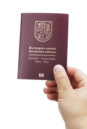 Man holding a Finnish (Finland) passport ih his hand. This is the new (2013) of the passport. Stock Photo - 22436876