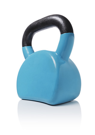 Modern ergonomic vinyl coated kettlebell isolated on white with natural reflection. Stockfoto