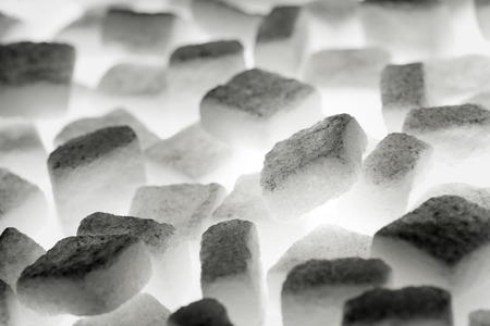White sugar cubes lit from below.
