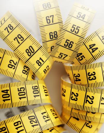 metric: Yellow metric tape measure. Short depth-of-field.