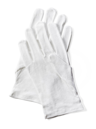 Pair of white protective  cotton gloves isolated on white with natural shadow.