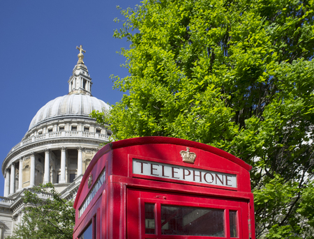 LONDON, UK – APRIL 15, 2014: Traditionan red english telephone booth in front of St. Pauls Cathedral.