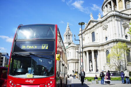 doubledecker: LONDON, UK – APRIL 15, 2014: Double-decker bus in front of Saint Pauls Cathedral. Editorial