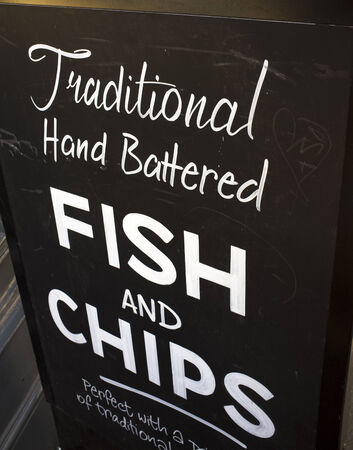 LONDON, UK – APRIL 15, 2014: Sign advertising british fast food, fish and chips.