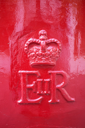 ii: LONDON, UK – APRIL 15, 2014: Detail of an English mailbox, the monogram of Queen Elizabeth II.