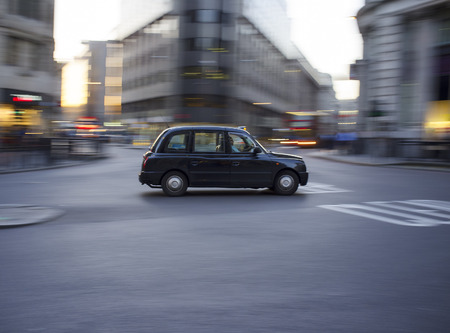 traditionally: LONDON, UK – APRIL 16, 2014: Motorised hackney cabs in the UK, traditionally all black in London and most major cities, are traditionally known as black cabs