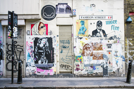 westend: LONDON, UK - APRIL 18, 2014: Graffiti, posters and stickers on Fashion Street, Spitalfields  Whitechapel. Editorial