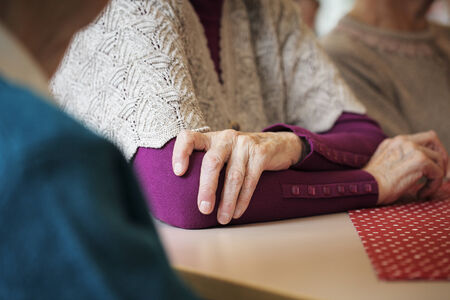 elbow sleeve: Hands of an old lady. Stock Photo