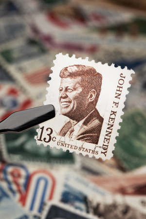 FINLAND - JANUARY 25, 2011: Commemorative U.S. stamp from 1967 depicting president John F. Kennedy. Editorial