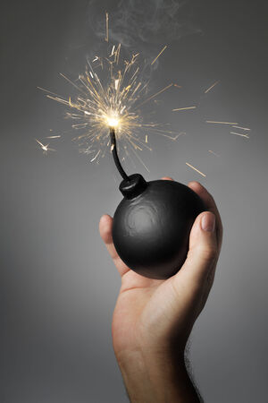 ignited: Man throwing an old-style (fake) bomb.