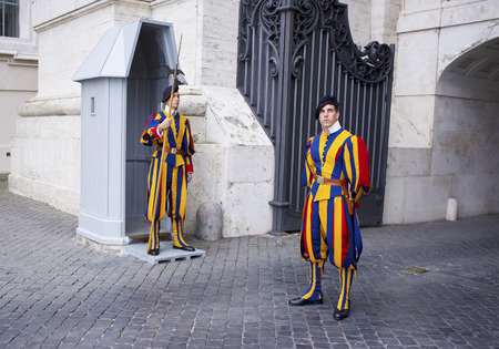 vatican city: VATICAN CITY, ITALY - SEPTEMBER 23, 2014: Swiss Guard posted at St. Peters Basilica, Vatican City. Editorial