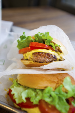 LONDON, UK - APRIL 16, 2014: Shake Shack is a fast casual restaurant chain based in New York City. This is their Shack Burger at Covent Garden, London.