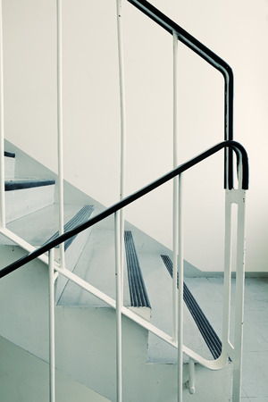 handrail: Old ugly and dirty staircase of a 1960s apartment building.