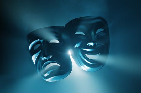 comedy tragedy: Crying and smiling masks in hazy light.