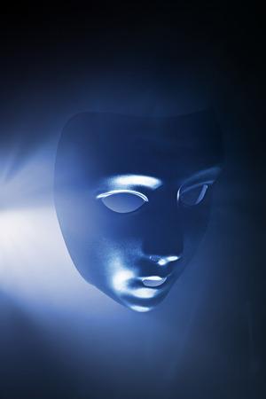 hallowen: Blank mask in blue hazy light. Short depth of field. Stock Photo