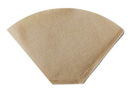 coffee filter: Coffee filter made of paper isolated on white with natural shadow.