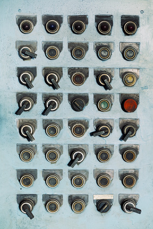 switches: Switches and buttons at an old abandoned factory.