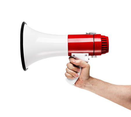 megaphone: Man holding a white and red megaphone in his hand.