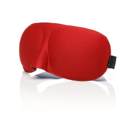 neoprene: Red sleep mask isolated on white with reflection.