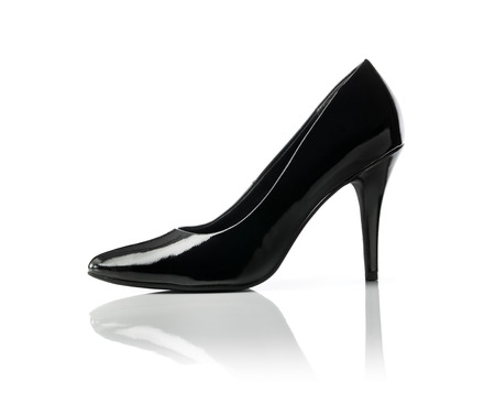 patent leather: Black shiny stiletto heel womens pump shoe on white.